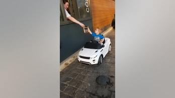 "EXCLUSIVE: A TWO-YEAR-OLD Austin Turner collects his McDonald's drive-thru order - which he placed from his toy electric car. Austin, two, ordered a cheeseburger from his mini Range Rover. Dad Paul, 40, from Doncaster, had let him pootle into the takeaway lane when it was quiet. Paul, of Doncaster, South Yorkshire, said: ""When we walked over to McDonald's there weren't many cars around, so I thought 'why not?' ""So I took him round to the drive thru. ""When we got to the window he just said 'I want a cheeseburger' and handed the money over. ""He had a big grin on his face as he did it."" Laughing staff and other drivers were bemused to see the toddler place his order from the miniature car. 23 Apr 2018 Pictured: A TWO-YEAR-OLD left McDonalds staff in hysterics when he went through the drive-thru in his toy pedal car. Photo credit: News Licensing / MEGA TheMegaAgency.com +1 888 505 6342 (Mega Agency TagID: MEGA208838_003.jpg) [Photo via Mega Agency]"