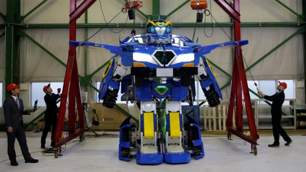 More than meets the eye: Engineers create robot that transforms into vehicle