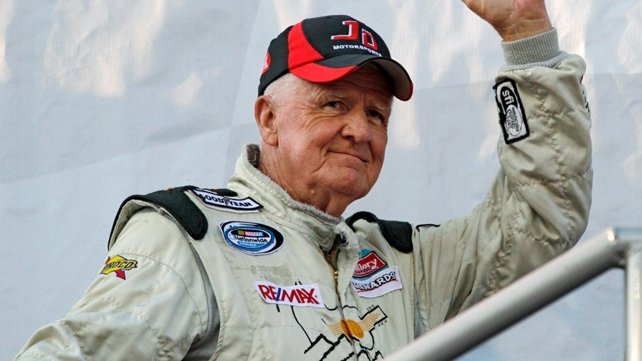 In this May 6, 2011, file photo, James Hylton beckons the crowd during driver introductions for the NASCAR Nationwide Series car race at Darlington Raceway in Darlington, SC