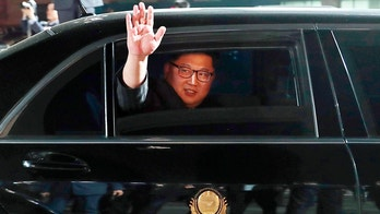 FILE - In this April 27, 2018 file photo, North Korean leader Kim Jong Un waves from a car as he returns to North Korea after the meeting with South Korean President Moon Jae-in at the border village of Panmunjom in the Demilitarized Zone, South Korea. Despite its feel-good emphasis on relationship-building, the first inter-Korean summit in more than a decade left a lot of question marks around the biggest and most contentious agenda item of them all: denuclearization. And that puts the ball squarely in the court of President Donald Trump, whose much anticipated sit-down with Kim is expected to be just weeks away. (Korea Summit Press Pool via AP, File)