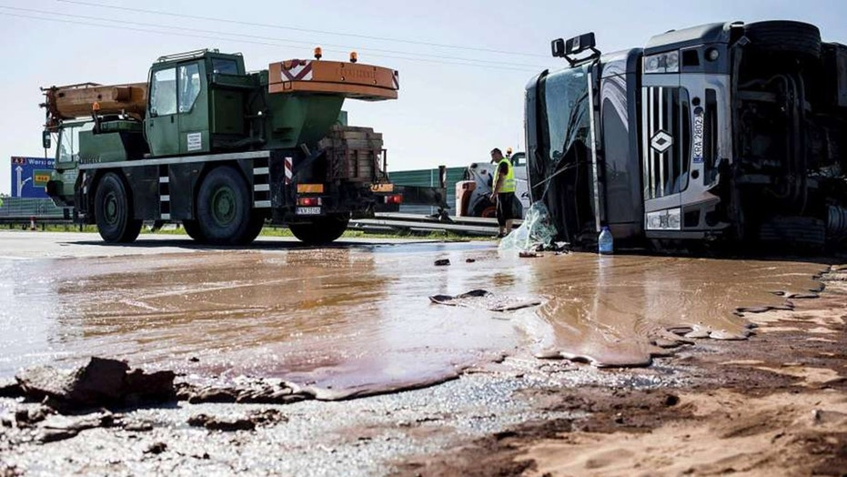 Liquid chocolate spilled across six lanes of traffic after semi truck overturns