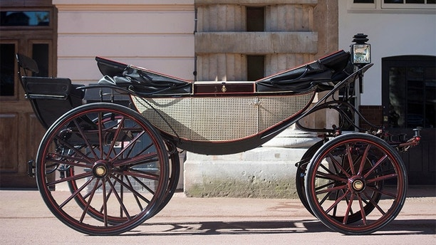 The Ascot Landau, which will be used in the case of dry weather for the wedding of Prince Harry and Meghan Markle, at the Royal Mews at Buckingham Palace, London Picture taken May 1, 2018. REUTERS/Victoria Jones/Pool - RC1527EA5ED0