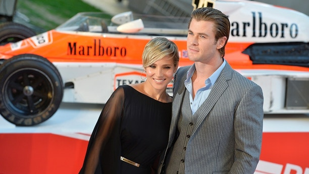 Actor Chris Hemsworth and his wife Elsa Pataki arrive at the world premiere of Rush at a cinema in Leicester Square, central London, September 2, 2013. REUTERS/Toby Melville (BRITAIN - Tags: ENTERTAINMENT SPORT MOTORSPORT) - LM1E9921D4M01