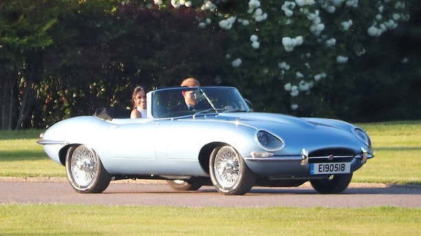 Prince Harry and Meghan driving away