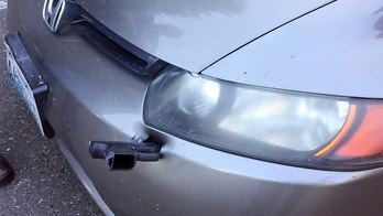 This Wednesday, May 23, 2018 photo provided by the Washington State Patrol shows a handgun embedded in the front bumper of a car in Lakewood, Wash. Authorities say a driver on Interstate 5 near Tacoma, Wash., saw a small object strike the front of his car during his evening commute. When he stopped for gas later, he saw that it was a handgun. The weapon was embedded in his bumper, barrel-end first, with the trigger sticking out just below the driver's-side headlight. The driver notified the Washington State Patrol, who recovered the gun, which was missing its magazine. (Washington State Patrol via AP)