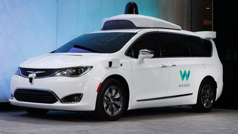 FILE -  In this Jan. 8, 2017, file photo a Chrysler Pacifica hybrid outfitted with Waymo's suite of sensors and radar is displayed at the North American International Auto Show in Detroit. A self-driving car service that Google spinoff Waymo plans to launch later this year in Arizona will include up to 62,000 Chrysler Pacifica Hybrid minivans under a deal announced Thursday, May 31, 2018. (AP Photo/Paul Sancya, File)