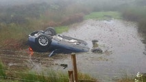 "A Sheffield, south Yorks., drink driver and his passenger had a miracle escape after he ploughed his flash BMW into a flooded farmer's field -- and the pair had to SWIM to safety. See Ross Parry story RPYBOOZED; A boozed-up teen BMW driver finished his night upside down in a pond while giving a pal a lift home after a few too many. Michael Mitchell, 19, and his passenger had to fight their way out of his BMW 1 Series hatchback after it plunged into a flooded field when he lost control of the vehicle. A court was told how foolish Mitchell had returned home after ""three or four pints"" during a night out but went out in the early hours to give his friend a lift home. Chesterfield Magistrates Court, Derbs., was told how the teen crashed into the flooded field during misty weather on Longside Road, Holymoorside on May 26. However the pair miraculously managed to escape the submerged, upside down vehicle and flagged a taxi home."