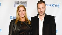 "FILE - In this Jan. 31, 2014 file photo, actress Mary McCormack, left, and husband Michael Morris attend ""Howard Stern's Birthday Bash,"" presented by SiriusXM, at the Hammerstein Ballroom in New York. McCormack has shared video of her husband's Tesla car shooting flames while in Southern California traffic. McCormack said in an accompanying tweet Friday, June 15, 2018, that there was ""no accident"" and the incident was ""out of the blue."" (Photo by Evan Agostini/Invision/AP, File)"