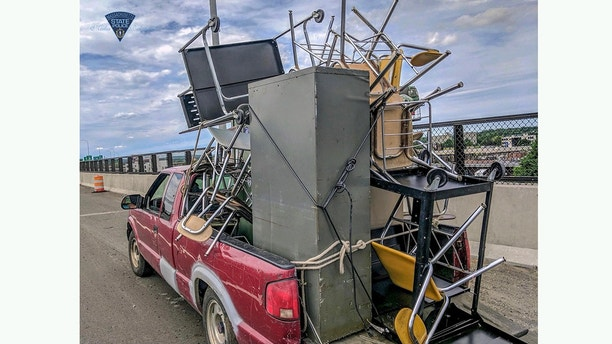 Overloaded Pickup Full Of Furniture Has Police Asking