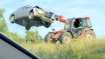 A farmer took matters into his own hands to remove a car which was abandoned in his field after the driver crashed and fled the scene. See MASONS story MNFIELD.  The Audi A4 ran off the road and on to land containing livestock - before the occupant got out and disappeared.  But the farmer wasn't hanging around for the driver to return and unceremoniously flung the car from his field in Ampthill, Beds., this morning (sun).  Traffic cops tweeted pictures of the silver saloon being hoisted into the air by a piece of farming machinery.