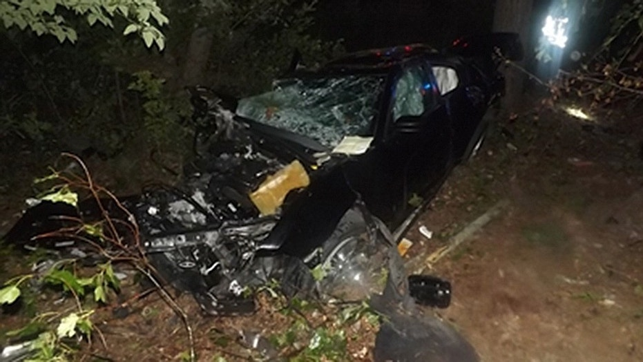 The man lost control at an intersection, drove through a guardrail and launched the 2013 Dodge Charger over 100 feet into the trees.