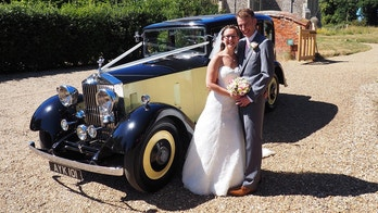 Eloise Britcher and Joseph Leney at their wedding. See MASONS story MNROLLS; A bride arrived at church in a vintage Rolls Royce that belonged to a long-lost relative - after discovering it while researching her family history.  Eliose Britcher, 31, stumbled upon a mention of the classic car while reading up on her great-great uncle Alfred Shread. The wealthy fruit and veg wholesaler had bought the car in 1934, before it passed into the hands of a former spitfire pilot. But it was when Eloise was searching for information about her ancestor that she found the motor for hire by a wedding car company.