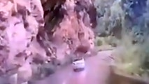 Pic shows: The moment the boulder crushes the car;