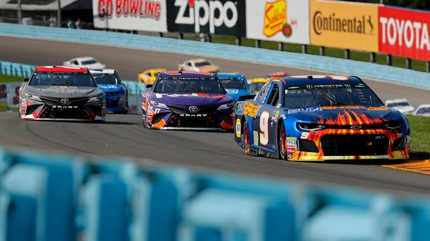 Chase Elliott (9) leads the pack through the esses during a NASCAR Cup Series auto race, Sunday, Aug. 5, 2018, in Watkins Glen, N.Y. (AP Photo/Julie Jacobson)