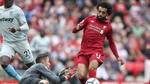 West Ham United goalkeeper Lukasz Fabianski makes a save from Liverpool's Mohamed Salah during the Premier League soccer match between Liverpool and West Ham United at Anfield, Liverpool, England. Sunday Aug. 12, 2018. (David Davies/PA via AP)