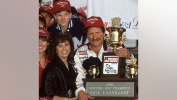 HAMPTON, GA - NOVEMBER 18: Dale Earnhardt celebrates in victory lane after clinching the NASCAR Winston Cup championship on November 18, 1990, at Atlanta Motor Speedway near Hampton, Georgia. The young boy in the upper left is Dale Earnhardt, Jr. (Photo by Bob Harmeyer/Archive Photos/Getty Images)