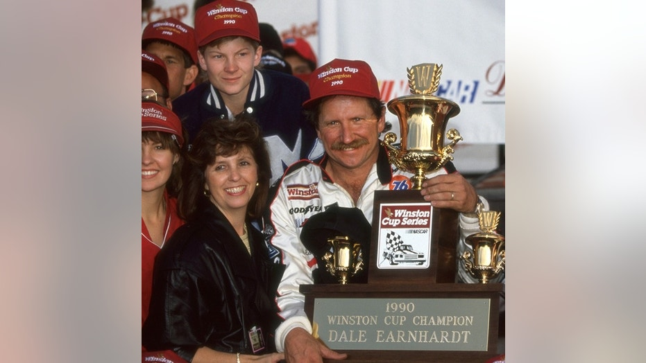 Dale Earnhardt and his son Dale Jr donned similar hats at the 1990 Winston Cup championship ceremony.
