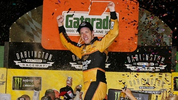 Brad Keselowski celebrates in Victory Lane after winning the NASCAR Cup Series auto race at Darlington Raceway, Sunday, Sept. 2, 2018, in Darlington, S.C. (AP Photo/Terry Renna)