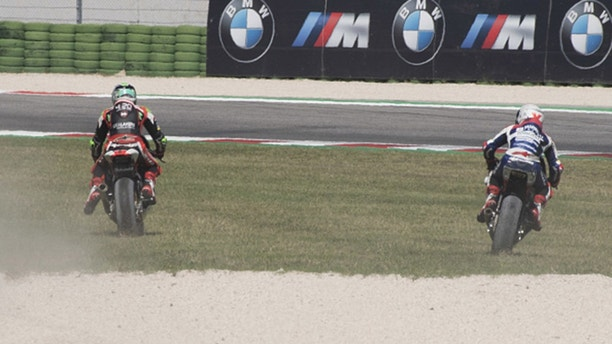 MISANO ADRIATICO, ITALY - SEPTEMBER 09:  Stefano Manzi of Italy and Forward Racing Team   and Romano Fenati of Italy and Marinelli Snipers Team (R) ride out of track  during the Moto2 race during the MotoGP of San Marino - Race at Misano World Circuit on September 9, 2018 in Misano Adriatico, Italy.  (Photo by Mirco Lazzari gp/Getty Images)