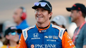 FILE - In this, April 7, 2018, file photo, driver Scott Dixon smiles before the IndyCar auto race at Phoenix International Raceway in Avondale, Ariz. Dixon has blazed his way through the record books to cement himself as the greatest IndyCar driver of his generation. One more championship will give him five, second in the open wheel record books only to A.J. Foyt.  (AP Photo/Rick Scuteri, File)