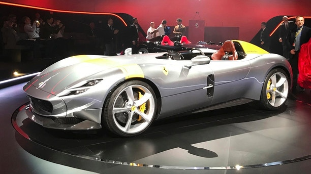 """The Ferrari Monza SP1 is displayed in Maranello, Italy, Tuesday, Sept. 18, 2018. Sportscar maker Ferrari has unveiled two updated versions of its classic open-top """"barchetta"""" racing model as it briefs investors on a new five-year business plan. Nicolo Boari, the head of product marketing, said Tuesday that the Ferrari Monza SP1 and SP2 are """"the most powerful ever in Ferrari history,"""" with an 810 horsepower engine able to reach 100 kilometers per hour (62 mph) in 2.9 seconds. (AP Photo/Collen Barry)"""