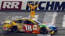 Kyle Busch (18) celebrates winning the NASCAR Cup Series auto race at Richmond Raceway in Richmond, Va., Saturday, Sept. 22, 2018. (AP Photo/Steve Helber)