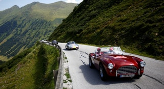 Participants drive their cars during the Ennstal Classic oldtimer rally on the road to Soelkpass, Austria July 20, 2017.  REUTERS/Leonhard Foeger - RTX3C8DB
