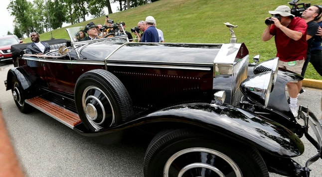 Pittsburgh Steelers wide receiver Antonio Brown, left, arrives in a chauffer driven 1931 Rolls Royce Phantom 1 for NFL football training camp in Latrobe, Pa., Thursday, July 27, 2017 . (AP Photo/Keith Srakocic)