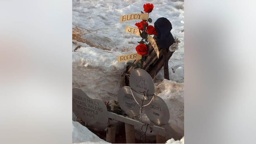 "**FILE** Flowers adourn a memorial Feb. 6, 1999, at the spot where the plane carrying Buddy Holly, Ritchie Valens, J.P. ""The Big Bopper"" Richardson and their pilot Roger Peterson crashed, killing all aboard Feb. 3, 1959, near Clear Lake, Iowa. The son of ""The Big Bopper,"" Jay Richardson, has hired a forensic anthropologist to answer questions about how his father died in the 1959 plane crash along with rock 'n' rollers Holly and Valens. (AP Photo/Rodney White, File)"