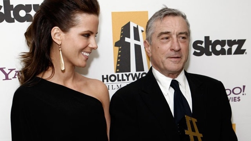 Oct. 26: Kate Beckinsale and Robert DeNiro pose backstage at the 13th annual Hollywood Awards.