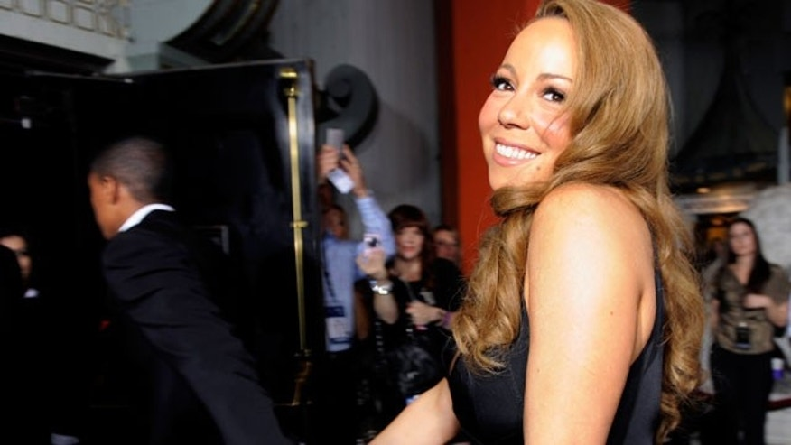 "Nov. 1: Mariah Carey and husband Nick Cannon attend the premiere of ""Precious"" in Los Angeles."