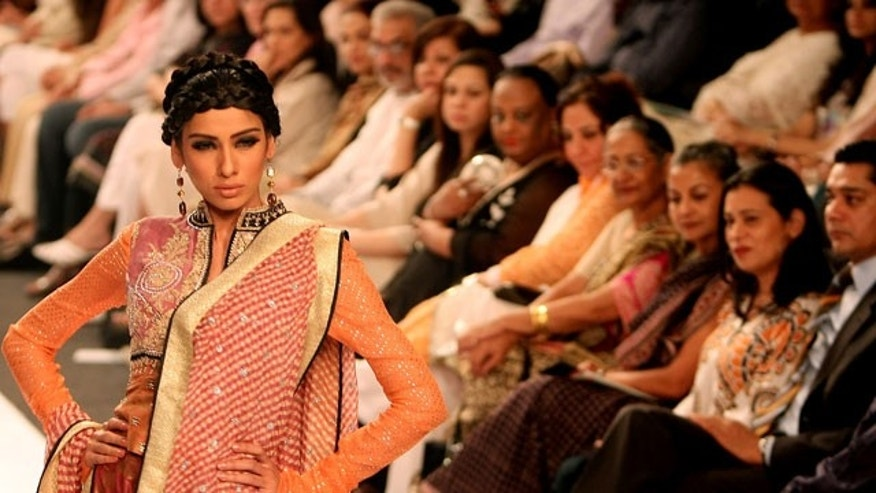 Nov. 7: A model displays a creation by Pakistani designer Faiza Samee during the Pakistan Fashion Week in Karachi, Pakistan.
