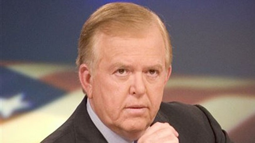 "In this 2005 file photo provided by CNN, news anchor Lou Dobbs sits on the set of his show, ""Lou Dobbs Tonight."""