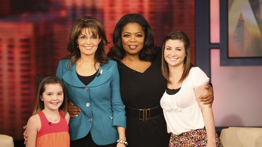 "Nov. 13: This photo taken by Harpo Productions, Inc., shows talk-show host Oprah Winfrey, second from right, with former Republican vice presidential candidate Sarah Palin and her daughters, Willow, right, and Piper, left, during the taping of ""The Oprah Winfrey Show"" in Chicago."