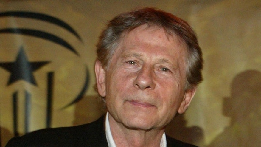 "Polish-born filmmaker and Academy Award winner Roman Polanski poses for the press during a screening of his film ""Oliver Twist"" in Jemaa El Fna square at the 6th Marrakesh International Film Festival in Marrakesh, Thursday, Dec. 7, 2006. The festival runs through Dec. 1-9. (AP Photo/Abdeljalil Bounhar)"