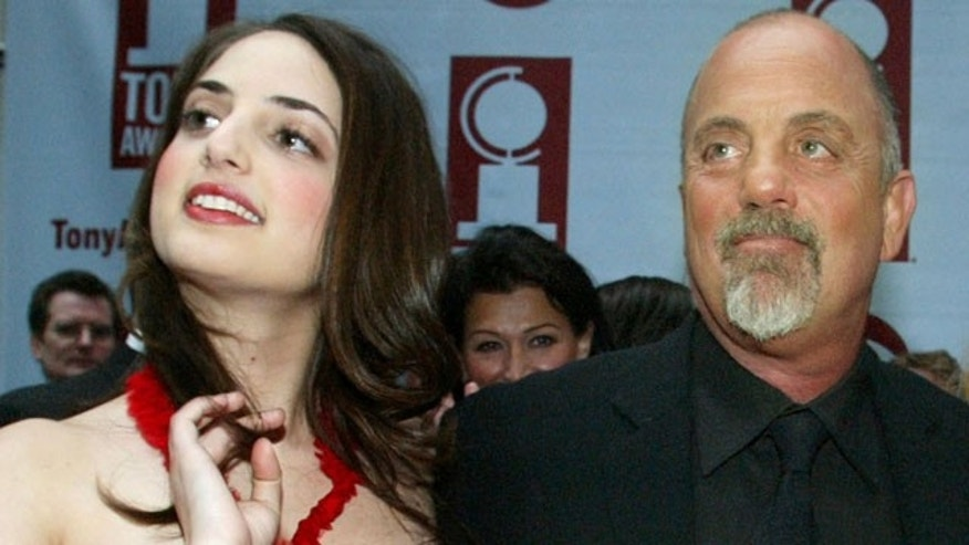 In this file photo, pianist, singer and songwriter, Alexa Ray Joel, left, joins her father, Billy Joel, for the arrivals of the 58th Annual Tony Awards at Radio City Music Hall, in New York.