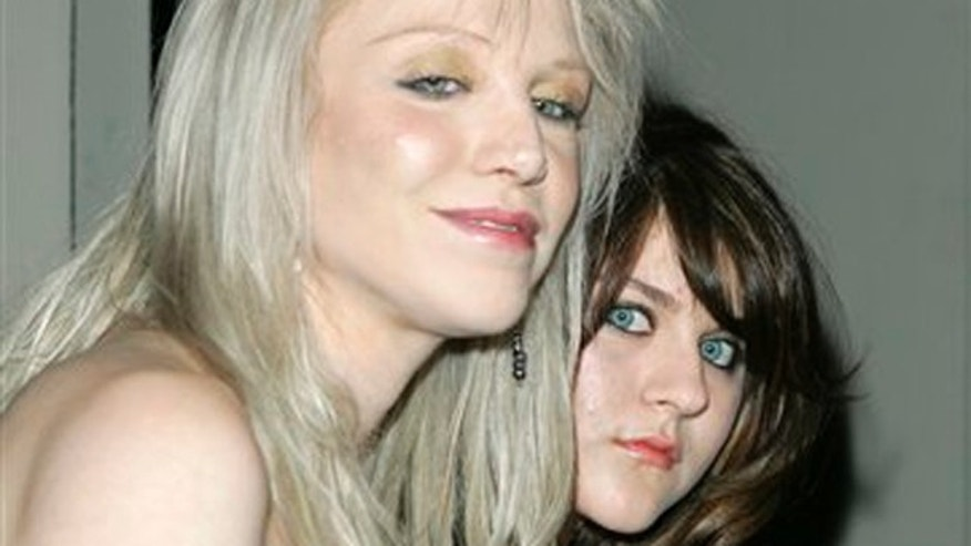 FILE - In this Feb. 8, 2007 file photo, singer Courtney Love and her daughter Frances Bean Cobain pose as they arrive at the City of Beverly Hills and the Rodeo Drive Committee event honoring Gianni Versace and his sister Donatella Versace with the Rodeo Drive Walk of Style Award in Beverly Hills, Calif. (AP Photo/Mark J. Terrill, file)