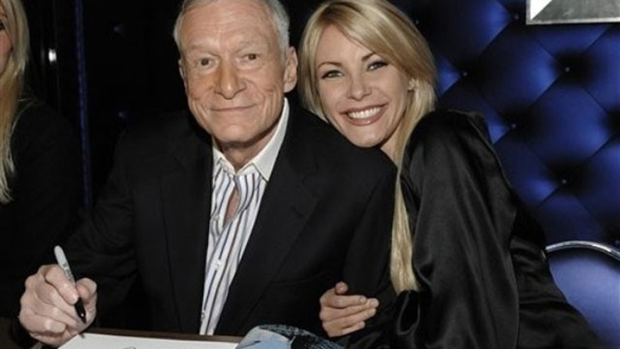 "Dec. 10: Hugh Hefner, left, and model Crystal Harris at a party celebrating the release of the book ""Hugh Hefner's Playboy"" a limited edition anthology by Taschen in Beverly Hills, Calif."