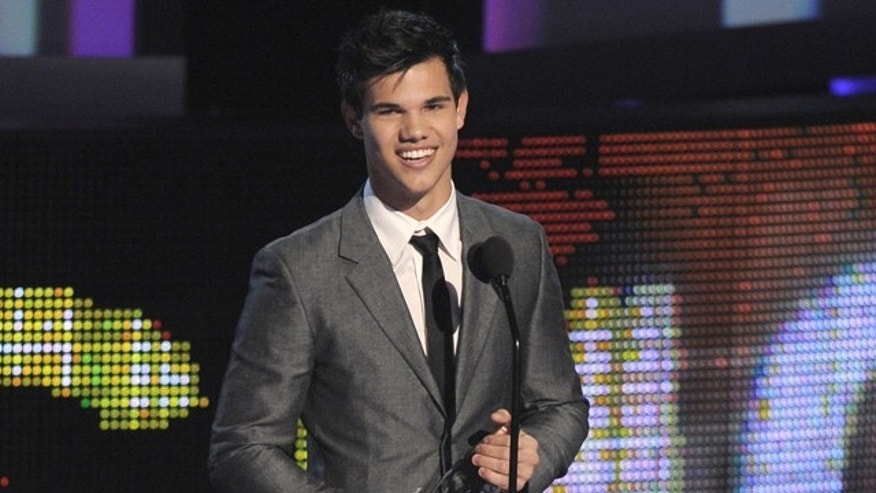Jan. 6: Taylor Lautner accepts the award for favorite breakout movie actor at the People's Choice Awards. (AP)