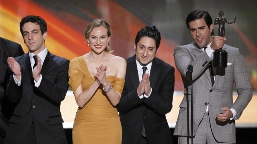 "Jan. 23: B.J. Novak, Diane Kruger, Omar Doom and Eli Roth accept the award for best cast of a movie for ""Inglourious Basterds."" (AP)"