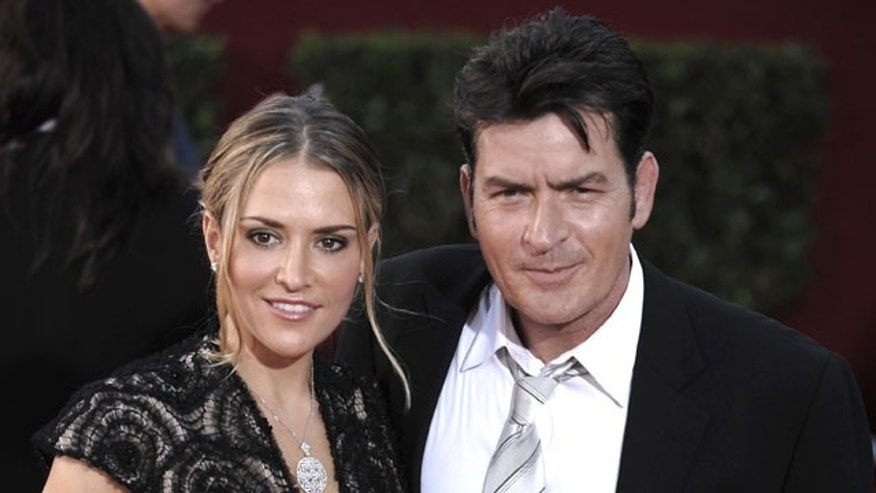 Charlie Sheen is shown with his wife Brooke Mueller.