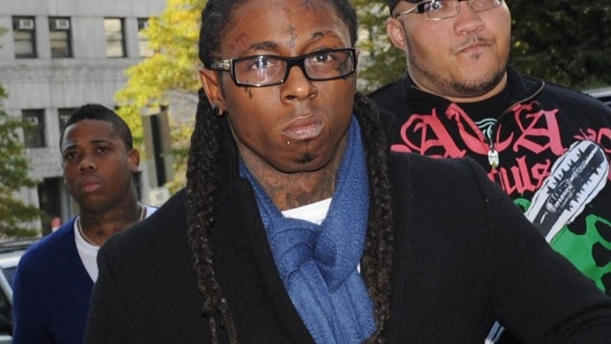 FILE: In this Oct. 21, 2009 photo, Rapper Lil Wayne enters Manhattan criminal court in New York.