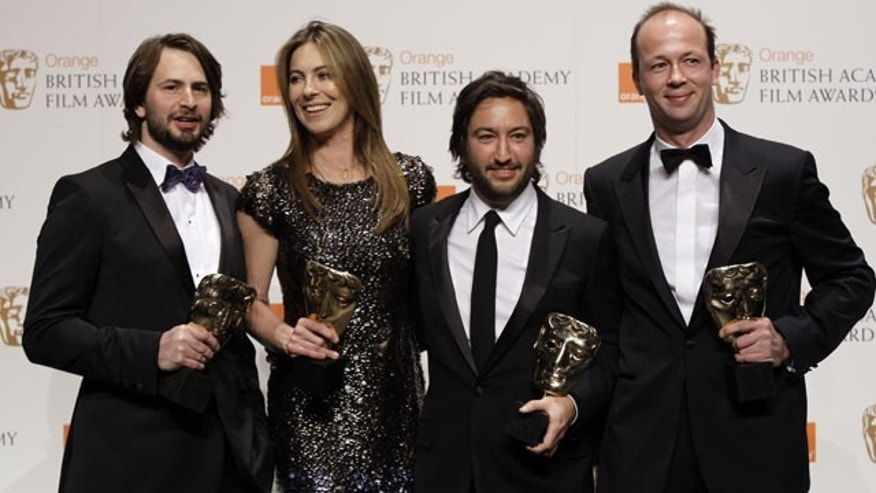 Feb. 21: From left to right, screeenwriter Mark Boal, director Kathryn Bigelow, producers Greg Shapiro and Nicolas Chartier, pose for the photographers with their awards for Best Film with their latest film ' The Hurt Locker', in the media room at the British Academy Film Awards 2010 at The Royal Opera House.