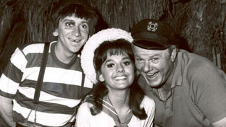 "Bob Denver, left, shown posing with fellow cast members of ""Gilligan's Island,"" Dawn Wells and Alan Hale Jr., in 1965 in Los Angeles"
