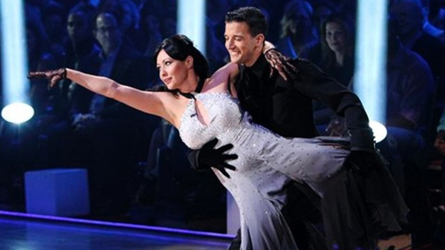 "In this publicity image released by ABC, actress Shannen Doherty, left, and her partner Mark Ballas perform on the celebrity dance competition series, ""Dancing With the Stars,"" Monday, March 22, 2010 in Los Angeles. (AP Photo/ABC, Adam Larkey)"