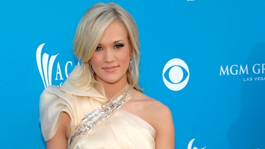 Apr. 18: Carrie Underwood arrives at the 45th Annual Academy of Country Music Awards in Las Vegas.