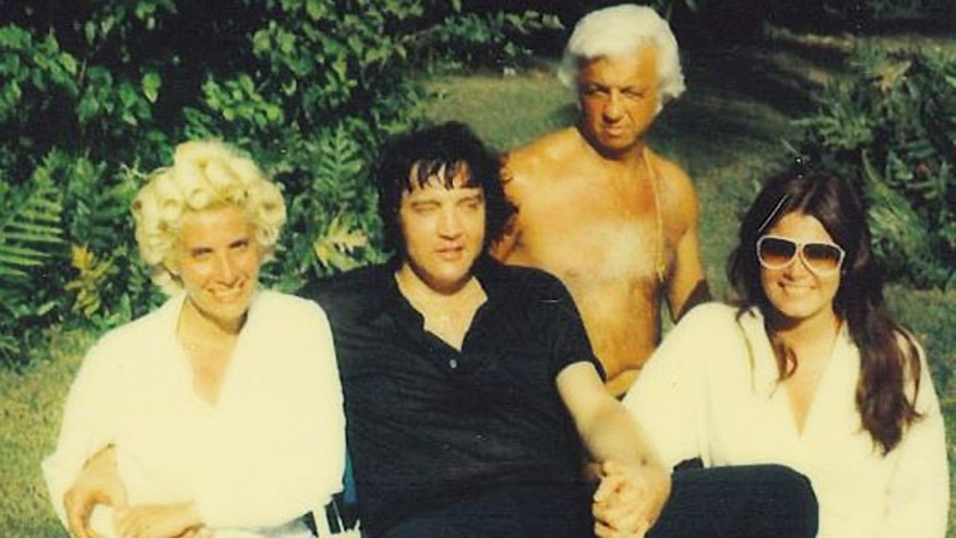 A photo of Elvis (center) with his doctor Nick Nichopoulos (back) taken shortly before his death.