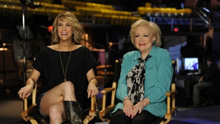 "May 4: In this publicity image released by NBC, cast member Kristen Wiig,left, and Betty White are shown on the set of ""Saturday Night Live."""