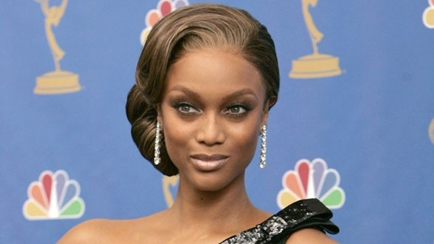 Tyra Banks poses at the 58th Annual Primetime Emmy Awards.