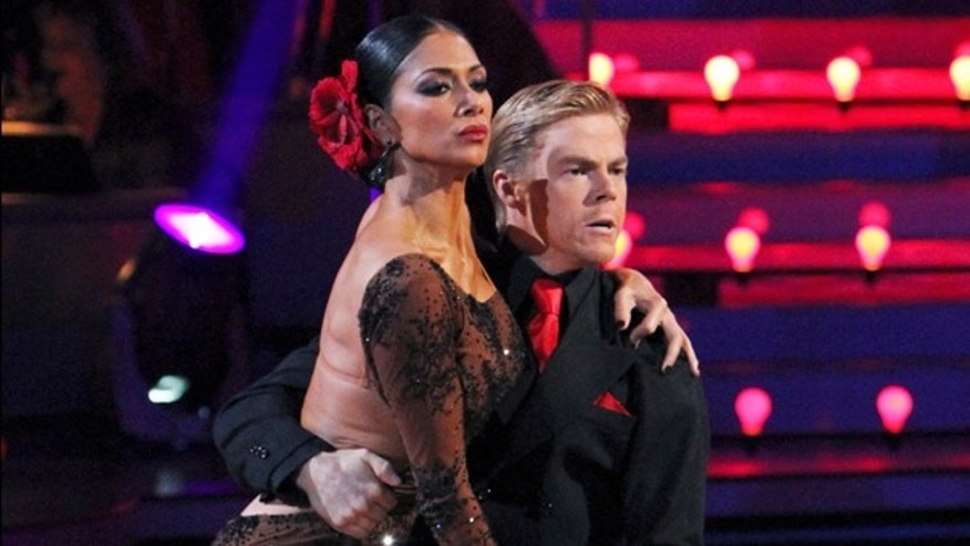 "Nicole Scherzinger and her partner Derek Hough perform on ""Dancing With the Stars"""
